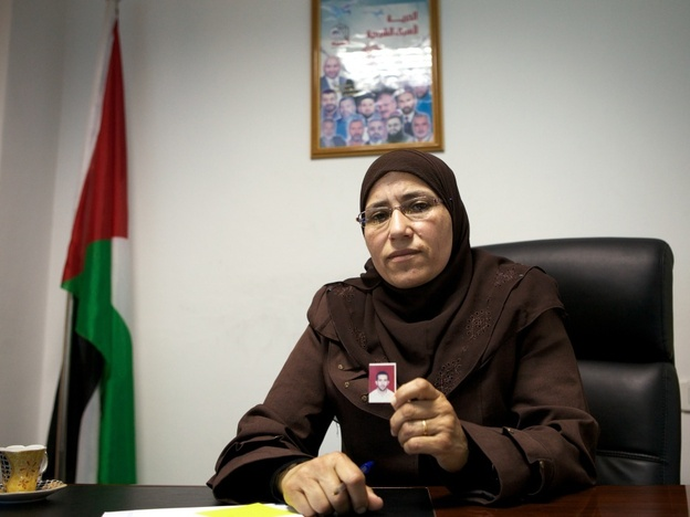Sameera al-Halayqa, a Hamas member of the Palestinian Legislative Council, holds a picture of her son who has been arrested twice by the Fatah-dominated security forces in Hebron.