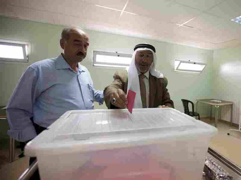 A voter casts his ballot to elect the board of the largest private medical association in the West Bank city of Hebron. Out of 14 people running, seven are backed by Fatah. There isn't a single candidate running under the Hamas banner.
