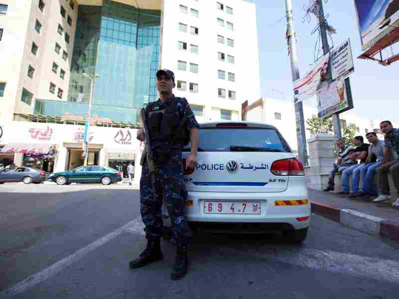 A Palestinian security officer is seen in Hebron. Security forces in the West Bank continue to be dominated by Fatah.