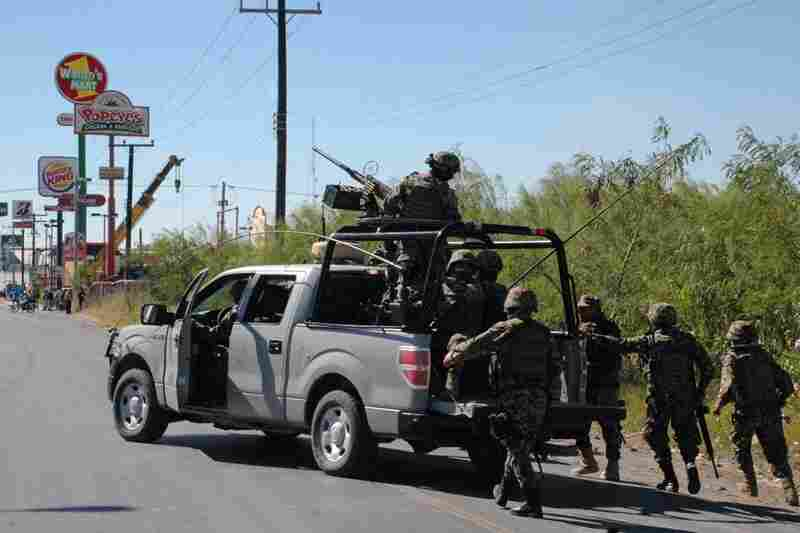 "Killed Nov. 5, 2010: Antonio Ezquiel Cardenas Guillen, aka ""Tony Tormento,"" the highest-profile leader of the Gulf Cartel, is shot dead during a gun battle with Mexican troops in the border city of Matamoros. Mexican troops walk behind an armored pickup truck during the firefight."