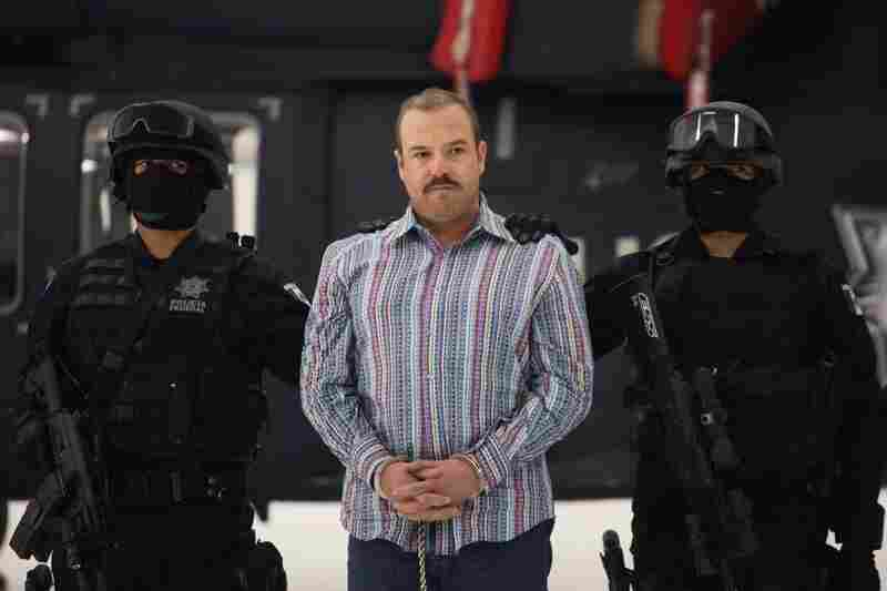 "Captured Nov. 23, 2010: Carlos Montemayor, aka El Charro, or ""The Cowboy,"" the alleged leader of the Beltran Leyva gang, appears with police officers a day after his arrest in Mexico City."