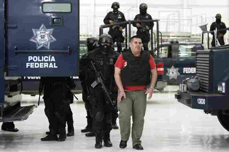 "Captured June 22, 2011: Jose de Jesus Mendez Varga, aka El Chango, or ""The Monkey,"" is paraded before the media in Mexico City a day after he w"