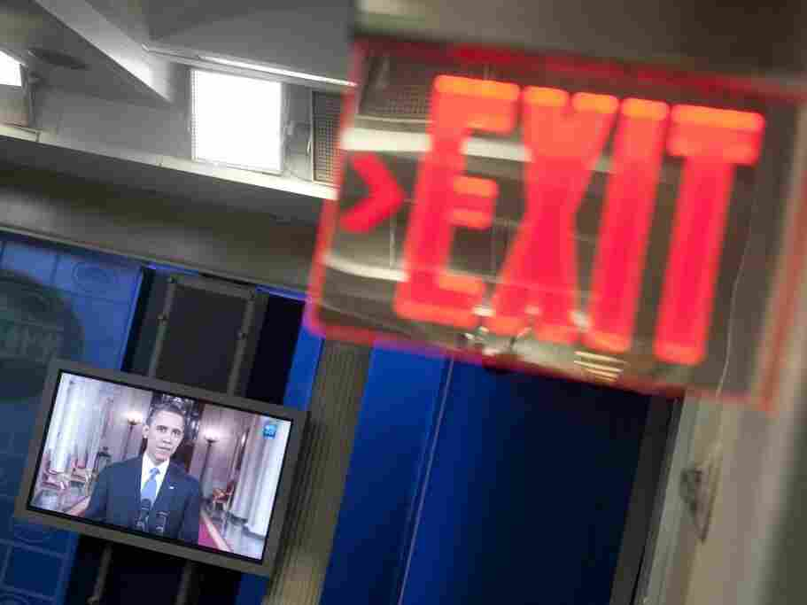 A television monitor in the White House briefing room displays  President Obama as he discusses his Afghanistan exit strategy, June 22, 2011.