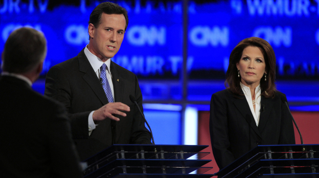 Former Pennsylvania Sen. Rick Santorum and Rep. Michele Bachmann, pictured here at the New Hampshire Republican presidential debate on June 13, have signed a pledge to push through anti-abortion measures if elected president. (AP)