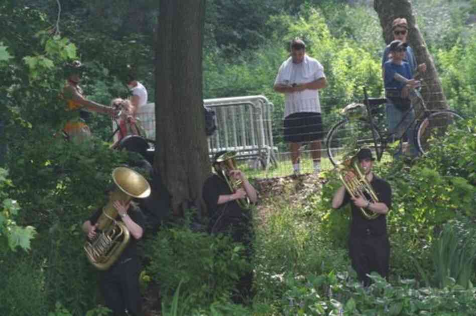 Park passers-by find three brass players springing out of the greenery along Central Park Lake during 'Swelter.'