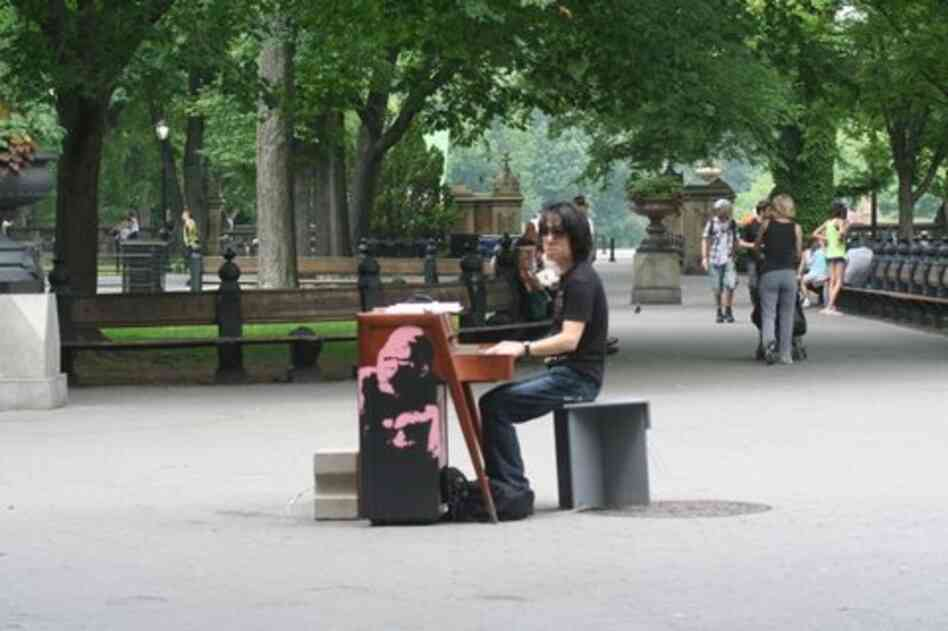 Japanese pianist Taka Kigawa at the guerilla piano near the bandstand in the middle of Central Park.