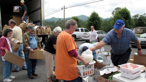 Residents in northeast Tennessee pick up items from a mobile food pantry in Chuckey, Tenn.