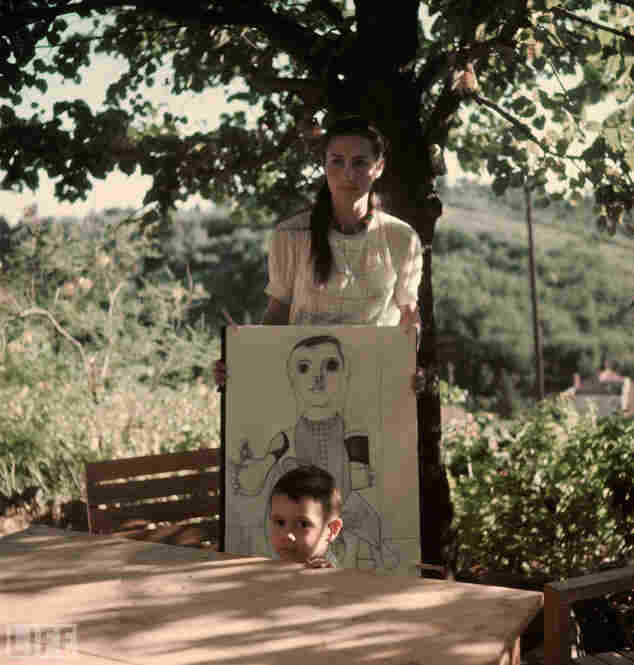 Among Picasso's muses was his mistress at the time of Mili's visit: Francoise Gilot. She was 21 and he was 61 when they first met. They had two children together, Claude and Paloma; here, in a never-published photo, 2-year-old Claude stands in front of his mother and a drawing of the boy by his famous father.