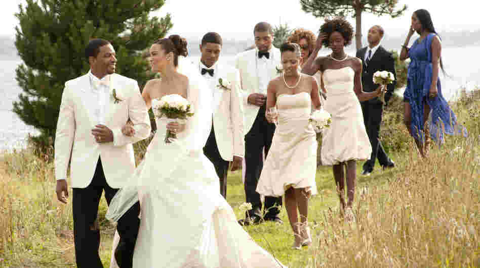 Laz Alonso (left) and Paula Patton star as a bride and groom from opposite ends of the socioeconomic spectrum in Jumping the Broom. The film grossed $36 million during its U.S. run in May.