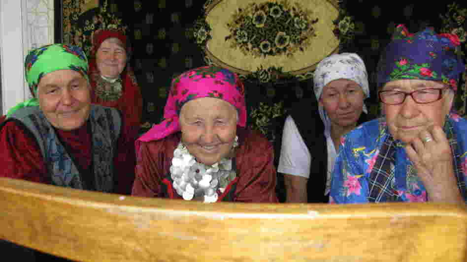 "The ""Buranovo Babushkas"" watch video, for the first time, of two of their members appearing on Russia's Who Wants to Be a Millionaire? program."