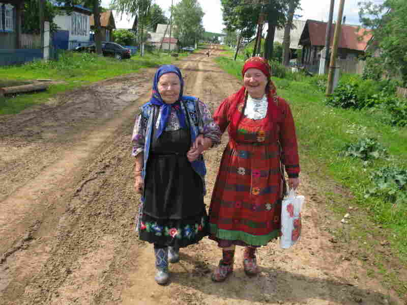 "Elizaveta Zarbatova (left), who walks with Alevtina Begisheva, is the oldest member of the group at 84. She was widowed in 1957 when her husband was  electrocuted on the job.                           ""After I lost my husband, I received some kind  of gift – the ability to compose music,"" she says. ""The music comes from the heart. The suffering  comes right from my heart."""