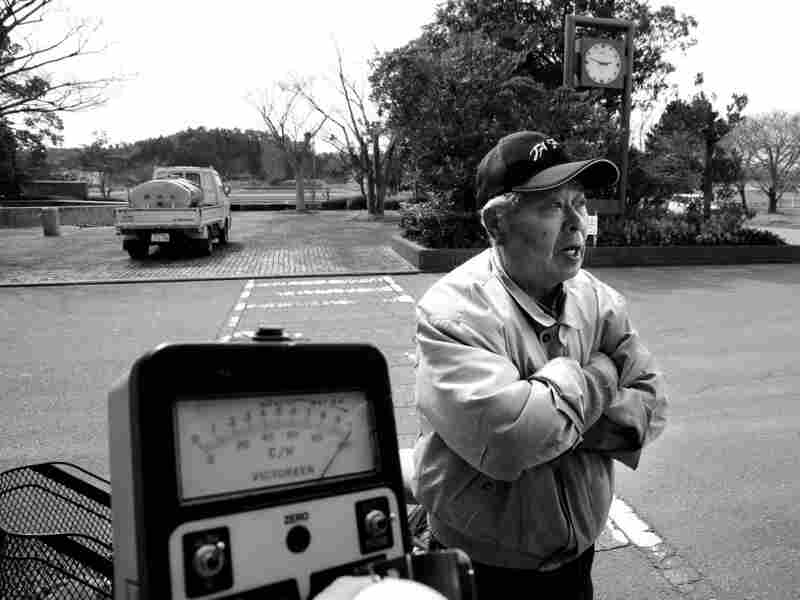 A Japanese man, who had believed official statements that radiation was not being released, expresses shock as a radiation monitor goes off the scale in this March 13 photo taken not far from the damaged Fukushima power plant.