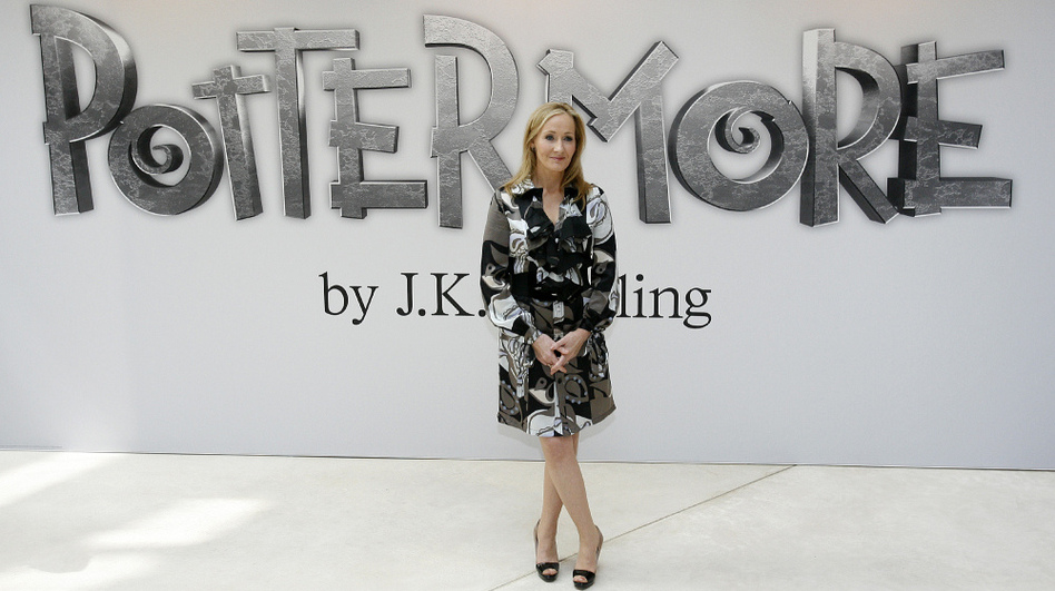 Author J.K. Rowling poses for photographers as she announces her new website project, Pottermore, at the Victoria and Albert Museum in London. Rowling says she has written new material about the characters, places and objects in the Harry Potter stories that will appear exclusively on the Pottermore site.