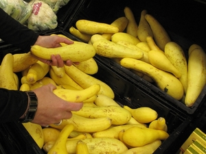 Walmart store manager Emily Bowman notices some yellow squash with brown spots — and takes about 40 off the shelves and puts them on a donation cart.  [Pam Fessler/NPR]
