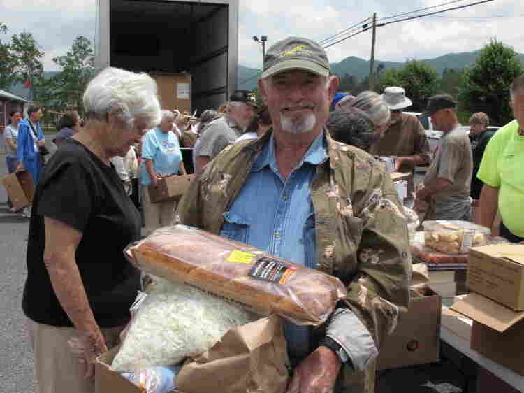 Robert Laws collects supplies from the Tennessee food bank's mobile pantry.