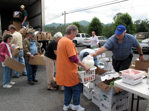 Residents of Chuckey, Tenn., pick up food from a food bank stocked by Walmart.