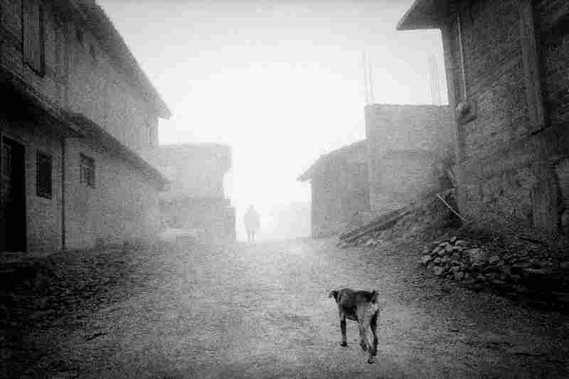 Fog settles on the deserted streets of San Miguel Cuevas, a Mixteca village in the highlands of Oaxaca. More than 80% of its population has emigrated to the United States, leaving it little more than a ghost town.