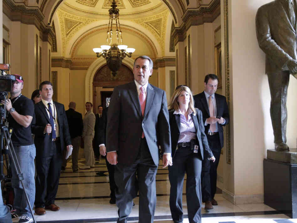 House Speaker John Boehner leaves the House floor after a vote on funding U.S. military action in Libya on Friday.