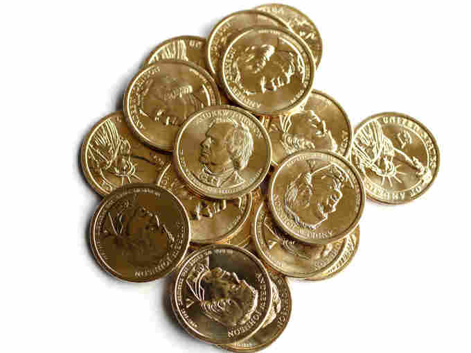 Golden dollar coins featuring Andrew Johnson, the 17th president of the United States.