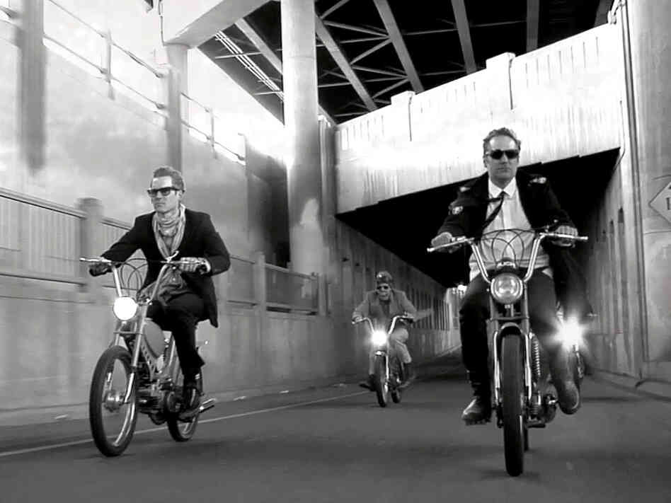 "The video for DeVotchKa's ""The Man From San Sebastian"" includes a thrilling chase scene with the band's members on vintage mopeds."