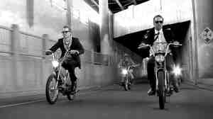 """The video for DeVotchKa's """"The Man From San Sebastian"""" includes a thrilling chase scene with the band's members on vintage mopeds."""