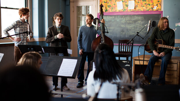 The Mason Jar team conducts a recording session with a chamber orchestra and The Wood Brothers (sitting on the desk, Chris on the left and Olive on the right) in a classroom at St. Cecilia's Church in Brooklyn.