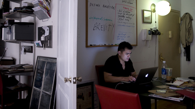 Jose Antonio Vargas works in his New York City apartment May 26. Vargas, a journalist, has revealed to the public that he is an illegal immigrant. (Courtesy of The Washington Post)