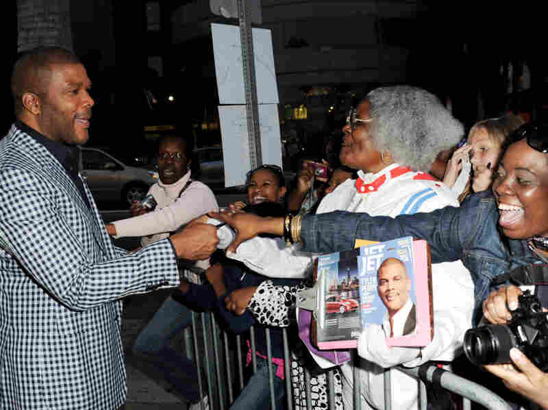 Writer/producer/director/actor Tyler Perry (left) greets fans at a screening of Lionsgate Films' Tyler Perry's Madea's Big Happy Family at the Cinerama Dome Theater on April 19 in Los Angeles.