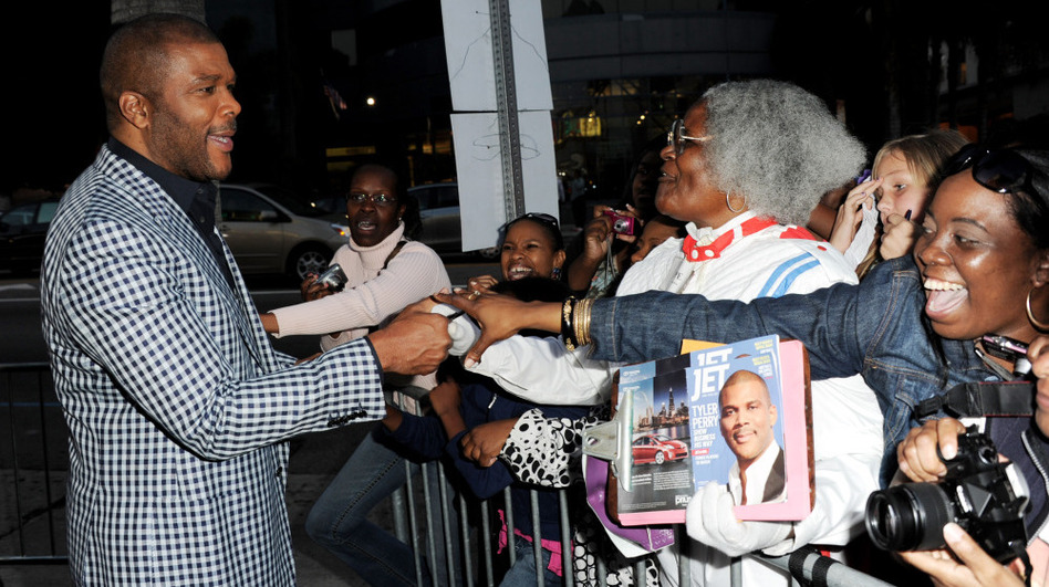 Writer/producer/director/actor Tyler Perry (left) greets fans at a screening of Lionsgate Films' <em>Tyler Perry's Madea's Big Happy Family</em> at the Cinerama Dome Theater on April 19 in Los Angeles.