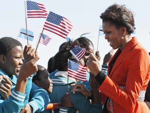 First lady Michelle Obama is greeted by children as she arrives in Gaborone, Botswana on June 24.
