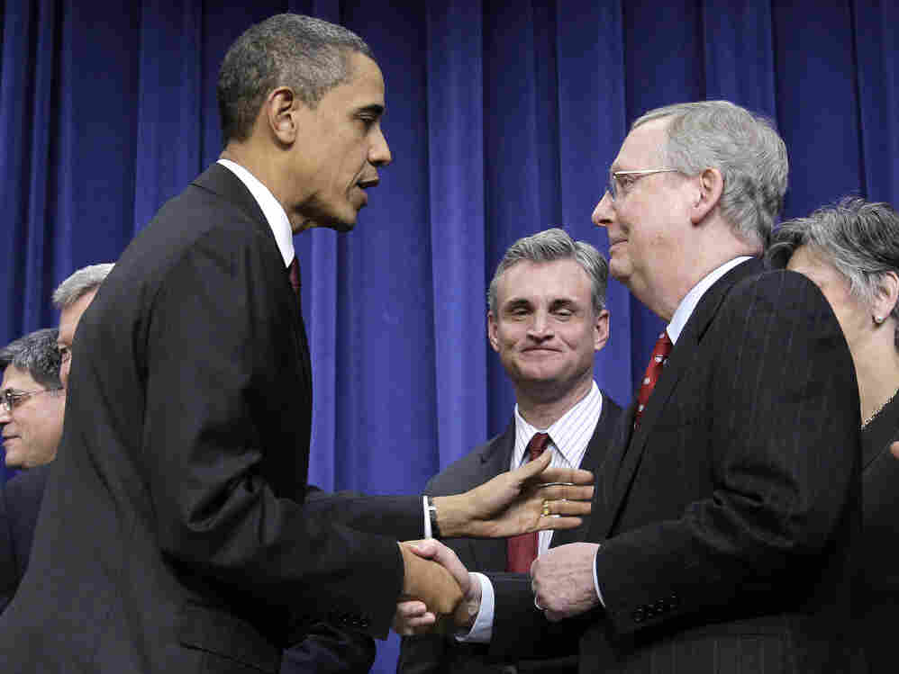 President Obama with Senate Republican Leader Mitch McConnell after making a tax deal, December 2010.