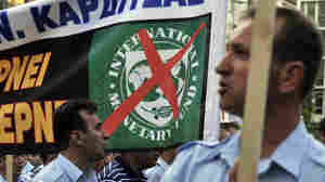 Greek police unions, coast guards and  firemen protest outside the finance ministry in Athens against the new austerity package.