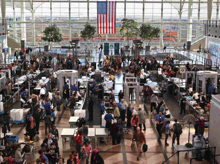 Passengers move through a main security checkpoint at the Denver International Airport last year. TSA employees have voted for union representation from the American Federation of Government Employees.