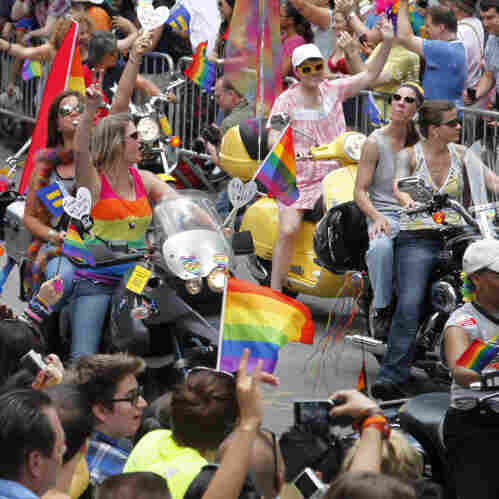 The annual Gay Pride parade works its way along Christopher Street in Greenwich Village on Sunday. The parade became a victory celebration after New York's historic decision to legalize same-sex marriage.