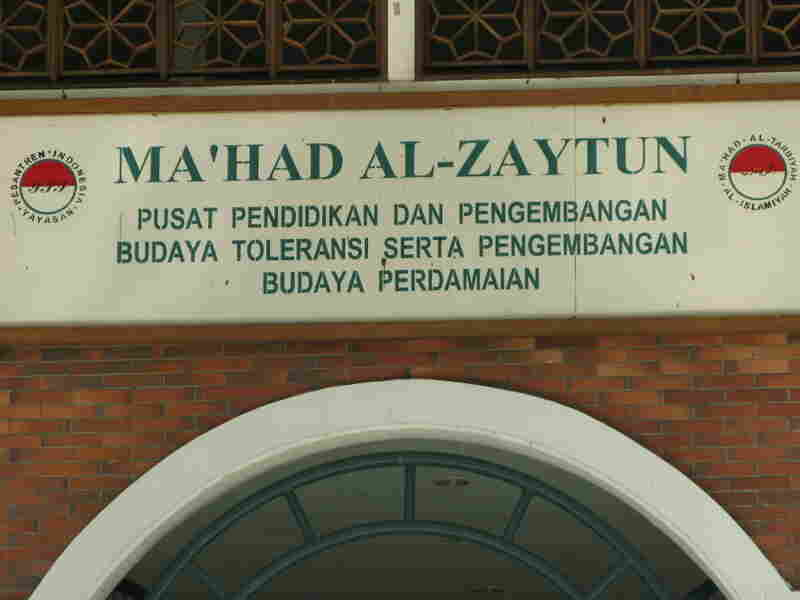 "The motto on a sign above the school's door emphasizes ""toleransi"" or  tolerance toward people of other ethnic and religious groups."