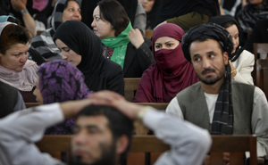 Defeated candidates from Afghanistan's September 2010 election wait for the resumption of proceedings of a special tribunal in a Kabul courtroom on Thursday. The tribunal decided that 62 members of Parliament would be replaced on fraud charges.