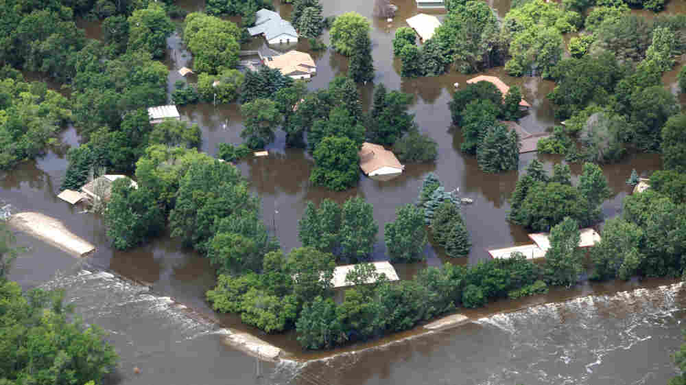 Floodwater from the Souris River surrounds homes in Burlington, N.D., on Monday.