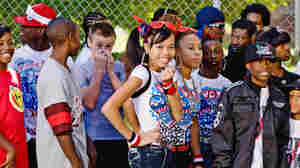 A line of extras wait for  entry and their chance to be part of a Soulja Boy music video.