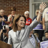 Rep. Michele Bachmann (R-MN) waves to a Waterloo, Iowa, crowd as she officially announces her intent to seek the Republican presidential nomination on June 27.