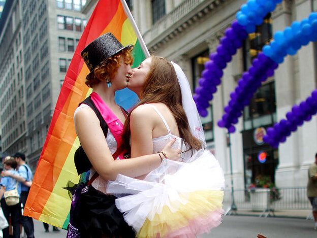 Two women celebrate the passage of New York's same-sex marriage law at Saturday's gay pride parade in New York City.