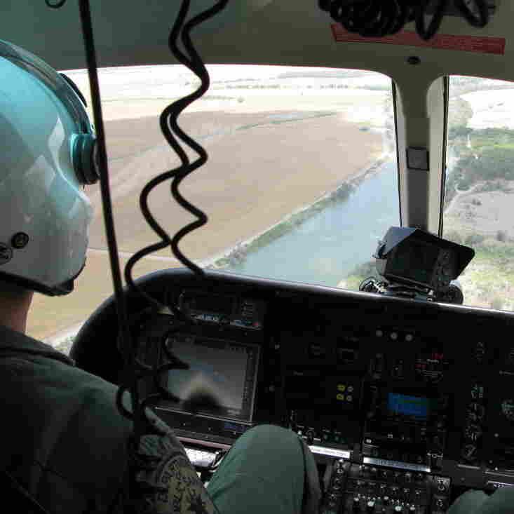 Texas Department of Public Safety pilots monitor the Rio Grande River near Los Ebanos, Texas.