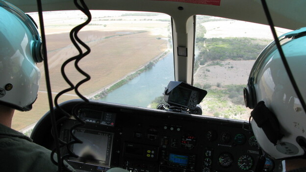 Texas Department of Public Safety pilots monitor the Rio Grande River near Los Ebanos, Texas. (NPR)