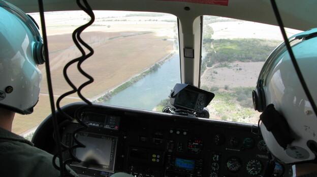 Texas Department of Public Safety pilots monitor the Rio Grande River near Los Ebanos, Texas. (NPR)