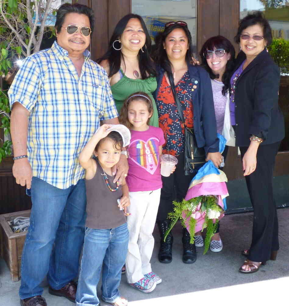 Jolivette and her family met up for  lunch after she and Charlyne filed their papers. Clockwise from top left: dad Ernesto; Jolivette; Charlyne; sister-in-law Regina; mother Dahlia; niece Leila; and nephew SoulKaya.