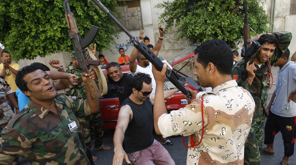 Libyan rebels in the rebel-held capital of Benghazi open fire as they celebrate after receiving the news of an arrest warrant issued against Moammar Gadhafi.  The International Criminal Court issued arrest warrants for Gadhafi, his son and his intelligence chief for crimes against humanity in the early days of their struggle to cling to power.
