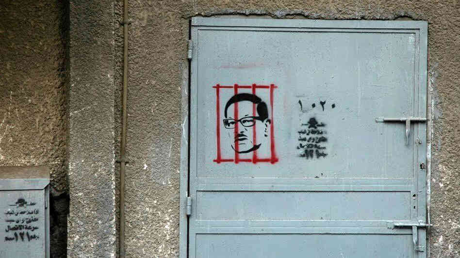 After the revolution, graphic artist Adham Bakry began stenciling the face of Safwat El Sherif, a member of Egypt's former ruling party, behind bars. El Sherif was arrested on corruption