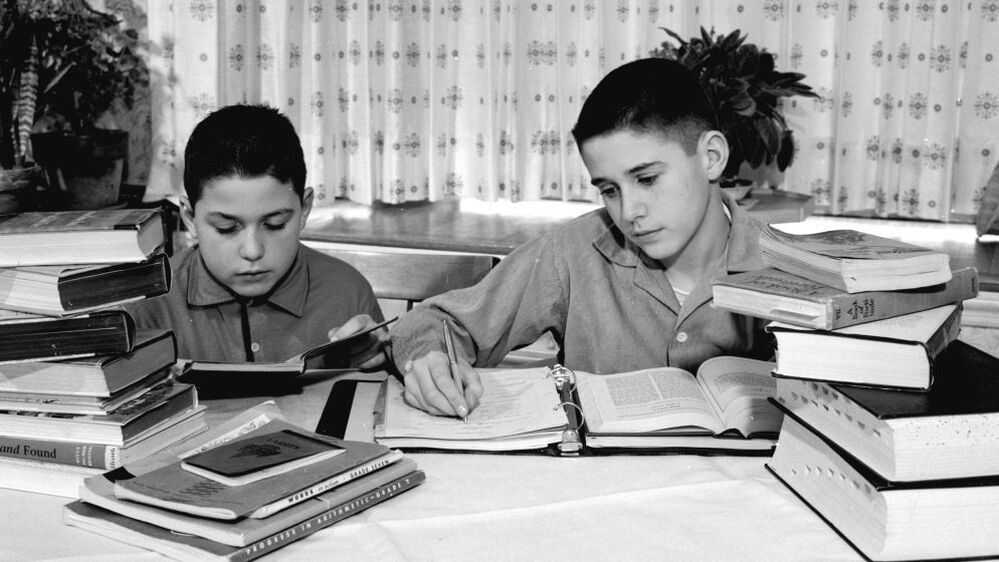 Two brothers doing their homework in a photo from around 1960.