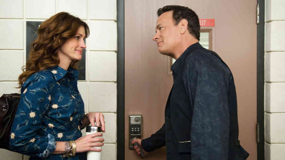 Hot For Teacher: Larry Crowne (Tom Hanks, right) woos his public speaking professor (Julia Roberts) in the midst of restarting his life after being laid off. Despite Roberts' lively performance, the film lacks enough emotional honesty to feel like an open reflection of current economic times.