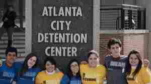 Young DREAMers including Viridiana Martinez (far right) and  David Ramirez (second from right) stand outside the Atlanta Detention Center after they were arrested for publicly displaying their illegal status in Atlanta on April 7.