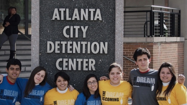 Young DREAMers including Viridiana Martinez (far right) and  David Ramirez (second from right) stand outside the Atlanta Detention Center after they were arrested for publicly displaying their illegal status in Atlanta on April 7. (Courtsey of the Immigrant Youth Justice League)